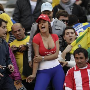 Paraguay's notorious soccer fan Larissa Riquelme poses for the photographers before a Copa America quarterfinal soccer match between Paraguay and Brazil  in La Plata, Argentina, Sunday July 17, 2011. (AP Photo/Felipe Dana)