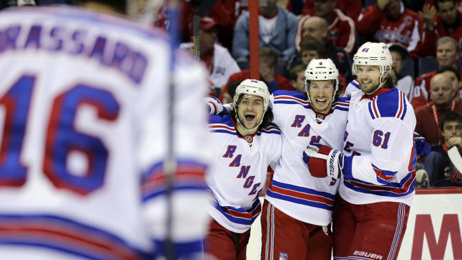 New York Rangers right wing Mats Zuccarello (36), from Norway, defenseman Michael Del Zotto (4), and left wing Rick Nash (61) celebrate Del Zotto's goal in the second period, of Game 7 first-round NHL Stanley Cup playoff hockey series against the Washington Capitals, Monday, May 13, 2013 in Washington. (AP Photo/Alex Brandon)