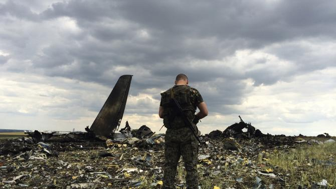 Ukraine vows to punish rebels who downed plane