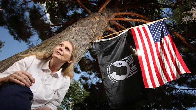 Lorna Bird Snyder in this undated photo, flies the POW MIA flag to honor her uncle, Vernal Bird, who was a World War II pilot in Papua New Guinea when his A-40 light bomber disappeared in the high mountains, in Springville, Utah. (AP Photo/The Salt Lake Tribune, Francisco Kjolseth)