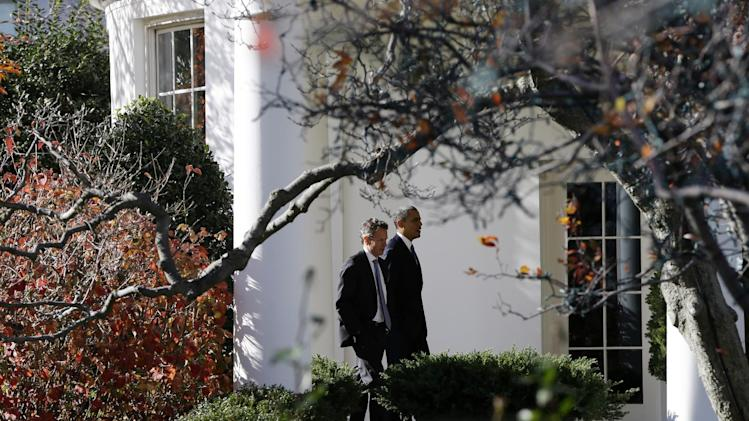 President Barack Obama walks with Treasury Secretary Timothy Geithner to the Oval Office at the White House in Washington, Wednesday, Dec. 5, 2012, as he returned from speaking about the fiscal cliff at Business Roundtable, an association of chief executive officers. (AP Photo/Charles Dharapak)