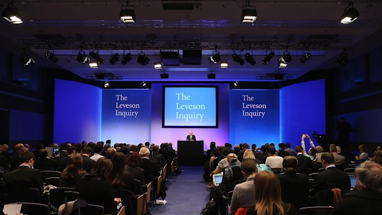 Britain's Lord Justice Brian Leveson, center back, delivers a statement following the release of the Leveson Inquiry report at the Queen Elizabeth II Centre, London, Thursday, Nov. 29, 2012. After a yearlong inquiry full of sensational testimony, Lord Justice Leveson released his report Thursday into the culture and practices of the British press and his recommendations for future regulation to prevent phone hacking, data theft, bribery and other abuses. (AP Photo/Dan Kitwood, Pool)