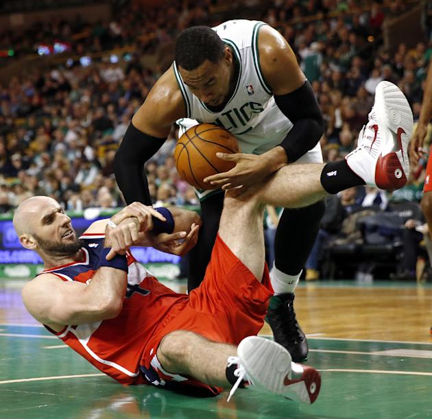 Boston Celtics' Jared Sullinger (7) and Washington Wizards' Marcin Gortat (4) battle for a loose ball in the third quarter of an NBA basketball game in Boston, Saturday, Dec. 21, 2013. The Wiz