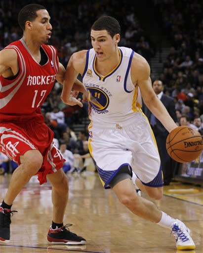 Thompson sparks Warriors past Rockets 106-97