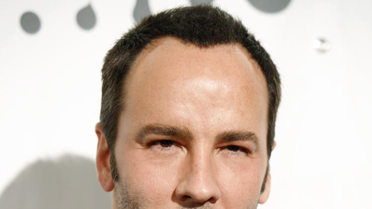 FILE - In this March 26, 2007 file photo designer Tom Ford arrives at the 18th annual GLAAD media awards in New York. A debut design showcase by singer Rihanna and Tom Ford's first proper catwalk show in London Fashion Week are headlining the five-day style extravaganza that begins Friday Feb. 15, 2013. (AP Photo/Diane Bondareff, file)