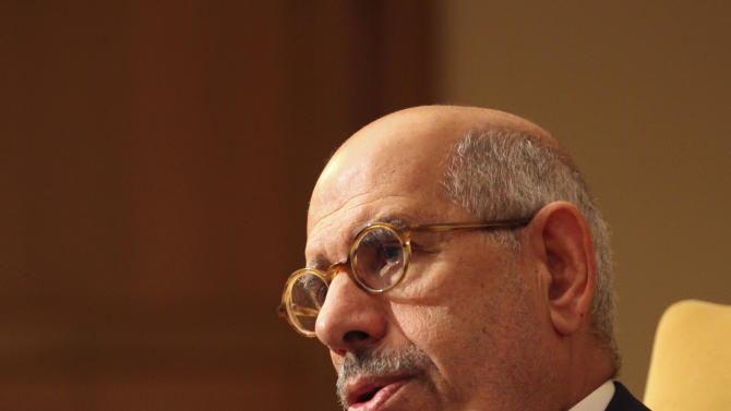 """Leading democracy advocate Mohammed ElBaradei speaks to a handful of journalists including the Associated Press saying dialogue with Egypt's Islamist president is not possible until he rescinds his decrees giving himself near absolute powers, at his home on the outskirts of Cairo, Egypt, Saturday, Nov. 24, 2012. ElBaradei, a Nobel Peace laureate for his past work as the head of the U.N. nuclear watchdog, has formed a """"National Salvation Front"""" with other liberal and secular leaders, trying to unify the opposition against Morsi. (AP Photo/Thomas Hartwell)"""