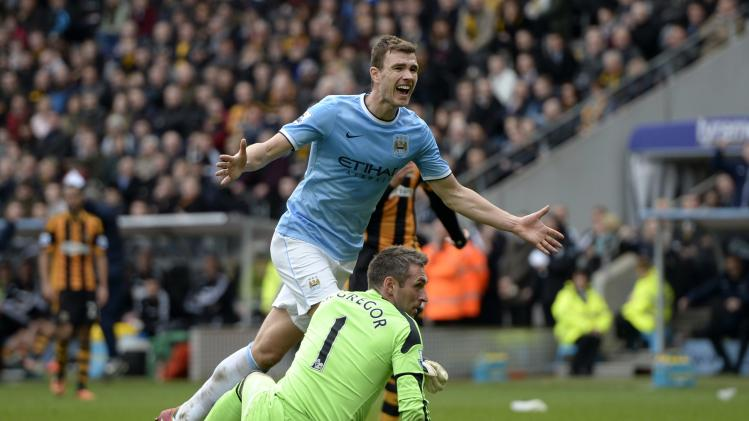 Manchester City's Dzeko celebrates after scoring a goal against Hull City during their English Premier League soccer match at the KC stadium in Hull