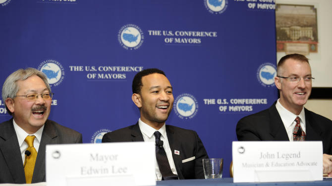 IMAGE DISTRIBUTED FOR EA - From left, Mayor Edwin Lee, of San Francisco; musician John Legend and Craig Hagen, Senior Director of Government Affairs at Electronic Arts, Inc. laugh during a panel on STEM education and the announcement of SimCity EDU by EA Maxis at the National Conference of Mayors, Friday, Jan. 18, 2013, in Washington.  (Photo/Nick Wass/Invision for EA)