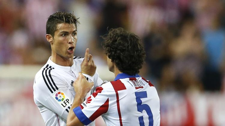 Real Madrid's Ronaldo argues with Atletico Madrid's Tiago during their Spanish Super Cup second leg soccer match at the Vicente Calderon stadium in Madrid