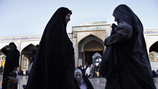 FILE - This April 22, 2009, file photo shows Iraqi women at the al-Sayda Zeinab shrine in southern Damascus, Syria. Iraqi Shiites increasingly fear the Muslim sect and its holy sites could be targeted in Syria, and Iranian-linked militants loyal to the faction are girding for a new eruption of retaliatory sectarian fighting, according to Iraqi Shiite leaders and government officials. (AP Photo/Ola Rifai, File)
