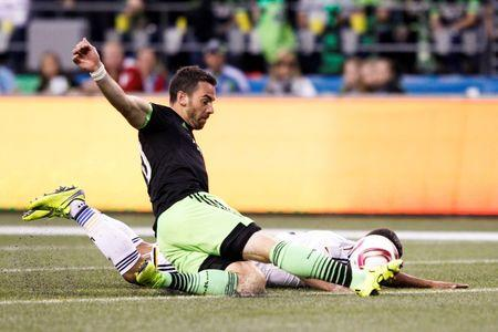 Sounders hold Galaxy to keep pace with playoff race