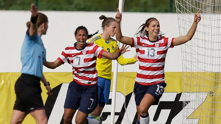 Alex Morgan, right, of the US, celebrates after scoring a goal against Sweden during their Algarve Cup  women's soccer match Monday, March 11, 2013, in Lagos, southern Portugal. (AP Photo/Armando Franca)