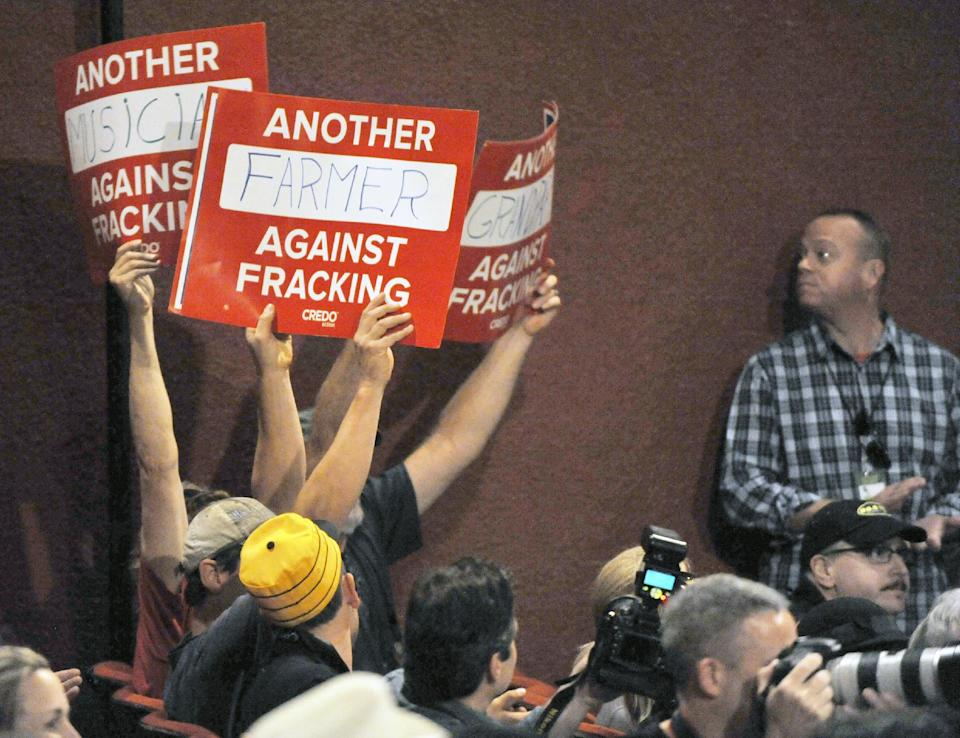 Anti-fracking (hydraulic fracturing) protesters hold signs during a news conference prior to the start of the Farm Aid 2013 concert at Saratoga Performing Arts Center in Saratoga Springs, N.Y., Saturday, Sept. 21, 2013. (AP Photo/Hans Pennink)