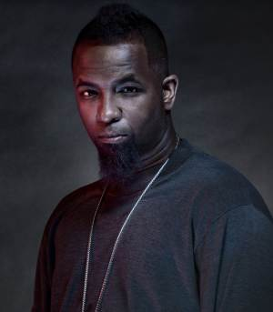 """In this publicity image released by Strange Music, rapper Tech N9ne, born Aaron Dontez Yates, is shown. His latest album, """"All 6's And 7's,"""" which was released in mid-June, debuted No. 4 on Billboard's Top 200 and topped the rap charts. (AP Photo/Strange Music, Alistair Tutton)"""