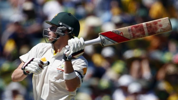 Australia's Smith hits a four during the first day of the third Ashes cricket test against England at the WACA ground in Perth