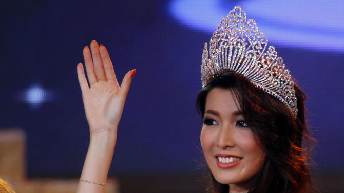 In this Thursday, Oct. 3, 2013 photo, Moe Set Wine poses for photos after she was crowned Miss Universe Myanmar at the National Theater in Yangon, Myanmar. Moe Set Wine will compete in the Miss Universe Contest in Moscow on Nov. 9. (AP Photo/Khin Maung Win)