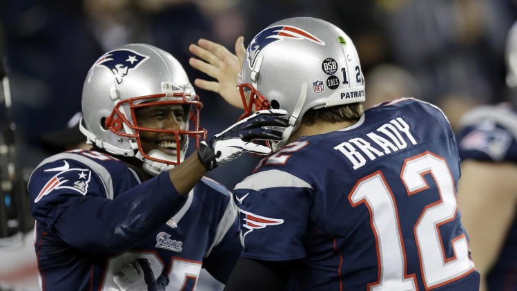 New England Patriots quarterback Tom Brady, right, congratulates teammate Brandon Lloyd after Loyd's five-yard touchdown pass from Brady during the second half of an AFC divisional playoff NFL football game against the Houston Texans in Foxborough, Mass., Sunday, Jan. 13, 2013. (AP Photo/Elise Amendola)