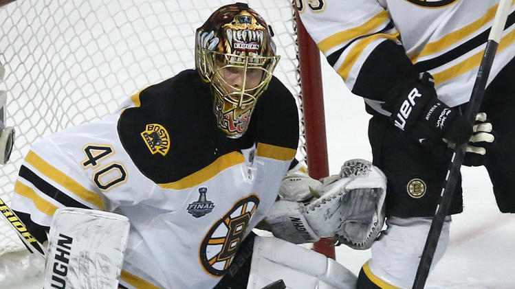 Boston Bruins goalie Tuukka Rask (40) watches the rebound after blocking a shot against the Chicago Blackhawks in the first period during Game 2 of the NHL hockey Stanley Cup Finals, Saturday, June 15, 2013, in Chicago. (AP Photo/Charles Rex Arbogast)
