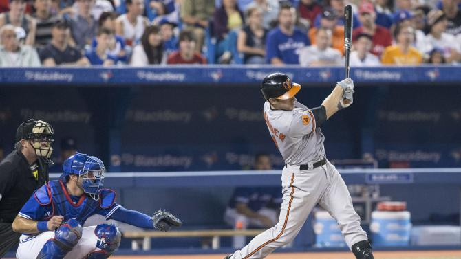 Baltimore Orioles' Taylor Teagarden, right, hits a home run Toronto Blue Jays catcher J.P Arencibia looks on during the eighth inning of a baseball game in Toronto, Saturday, June 22, 2013. (AP Photo/The Canadian Press, Chris Young)
