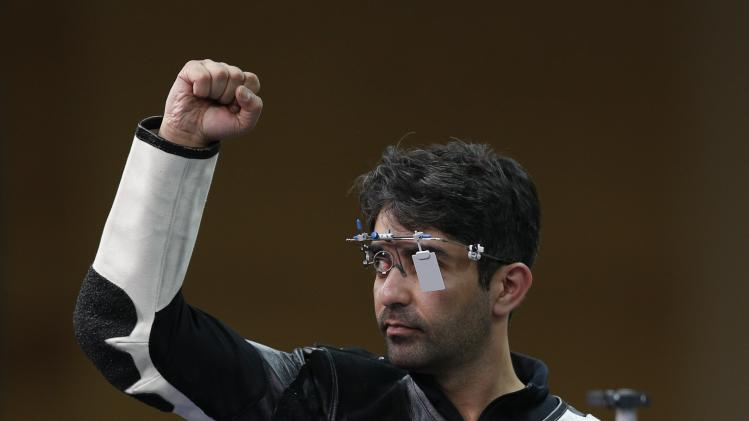 India's Abhinav Bindra celebrates winning the men's 10m air rifle shooting event at Barry Buddon shooting centre at the 2014 Commonwealth Games in Glasgow, Scotland