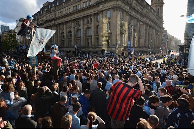 Fans Climb On Any Available Vantage Point As Manchester City Players Parade The Barclays Premier League Trophy In Getty Images