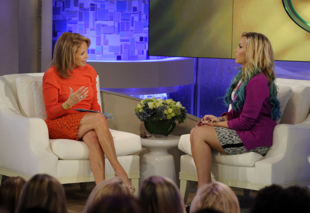 This undated photo released by ABC shows host Katie Couric, left, with actress-singer and judge on the singing competition series &quot;The X Factor,&quot; Demi Lovato during the taping of an appearance on &quot;Katie,&quot; in New York. The interview will air on Monday, Sept. 24. (AP Photo/Disney-ABC Domestic Television, Ida Mae Astute)