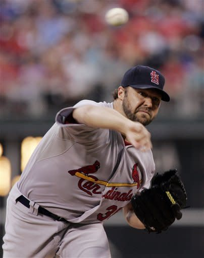 Holliday leads Cardinals over Phillies