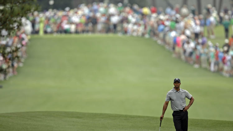 Tiger Woods waits to hit off the first fairway during the first round of the Masters golf tournament Thursday, April 11, 2013, in Augusta, Ga. (AP Photo/Matt Slocum)