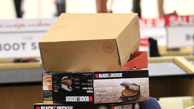 Yuri Montes carries boxes as she shops at Kohl's  during Black Friday on Thursday Nov. 27, 2014 in McAllen, Texas, Texas. (AP Photo/The Monitor, Gabe Hernandez)