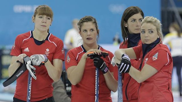 Britain's Claire Hamilton (L-R), Vicki Adams, skip Eve Muirhead and Anna Sloan stand together during their women's curling round robin game against Switzerland (Reuters)
