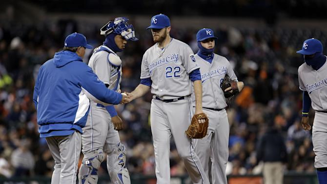 Kansas City Royals pitcher Wade Davis (22) hands the ball to manager Ned Yost in the fourth inning of a baseball game against the Detroit Tigers in Detroit, Wednesday April 24, 2013. (AP Photo/Paul Sancya)