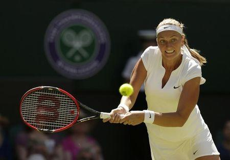 Petra Kvitova of Czech Republic hits a shot during her match against Kiki Bertens of the Netherlands at the Wimbledon Tennis Championships in London