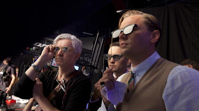 """This film publicity image released by Warner Bros. Pictures shows director Baz Luhrmann, left, with actors Tobey Maguire, and Leonardo DiCaprio in a scene from """"The Great Gatsby."""" Luhrmann will open the 66th Cannes Film Festival on Wednesday, May 15, 2013, with the international premiere of """"The Great Gatsby.""""  (AP Photo/Warner Bros. Pictures, Douglas Kirkland)"""