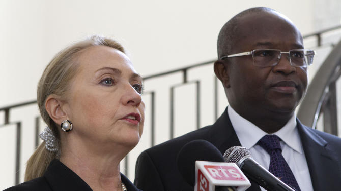 Secretary of State Hillary Rodham Clinton, accompanied by Senegali President Macky Sall, speaks at the Presidential Palace in Dakar, Senegal, Wednesday, Aug. 1, 2012. (AP Photo/Jacquelyn Martin, Pool)