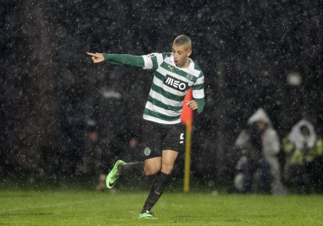 Sporting Lisboa's Slimani celebrates his goal against Arouca during their Portuguese Premier League soccer match in Arouca