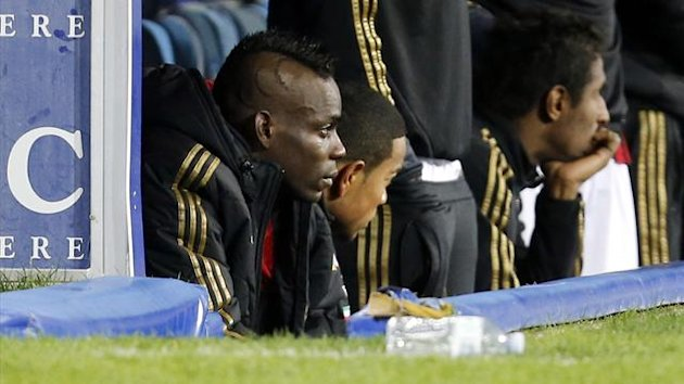 AC Milan's Mario Balotelli reacts as he sits on the bench during their Italian Serie A soccer match against Napoli at San Paolo stadium in Naples February 8, 2014 (Reuters)