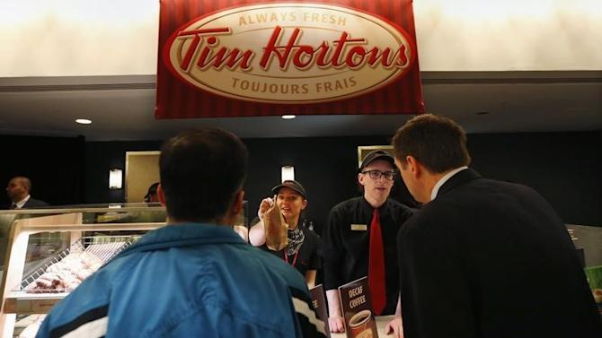 Tim Hortons employees serve shareholders before the company's annual general meeting in Toronto