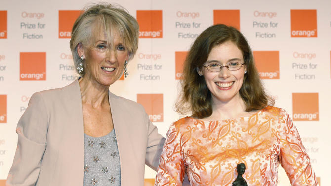 American author Madeline Miller, right, poses for pictures after she received her award from Joanna Trollope, left, the chair of the judges of the 2012 Orange for Fiction award in London's Royal Festival Hall, Wednesday, May 30, 2012. Miller won the won the prestigious book award with her book  'The Song of Achilles' . (AP Photo/Lefteris Pitarakis)