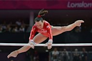 Britain's gymnast Beth Tweddle performs on the uneven bars during the women's qualification of the artistic gymnastics event of the London Olympic Games at the 02 North Greenwich Arena in London