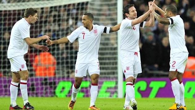 England's midfielder Frank Lampard (2R) celebrates after scoring England's second goal with England's defender Glen Johnson (R) England's midfielder Theo Walcott (2L) and England's midfielder Steven Gerrard