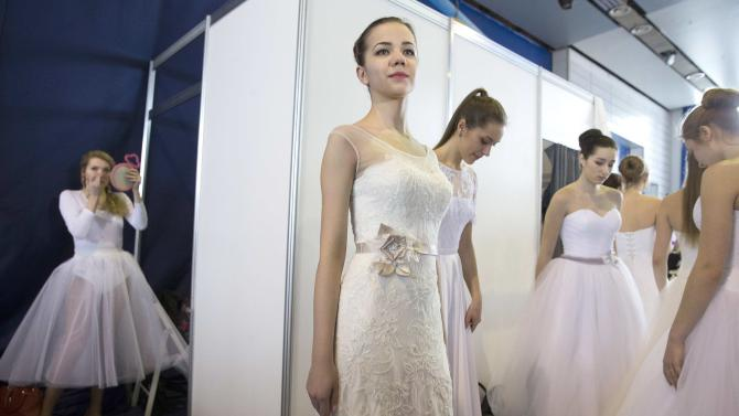 "Models wait for the start of the 4th ""My Wedding"" international exhibition in Minsk"