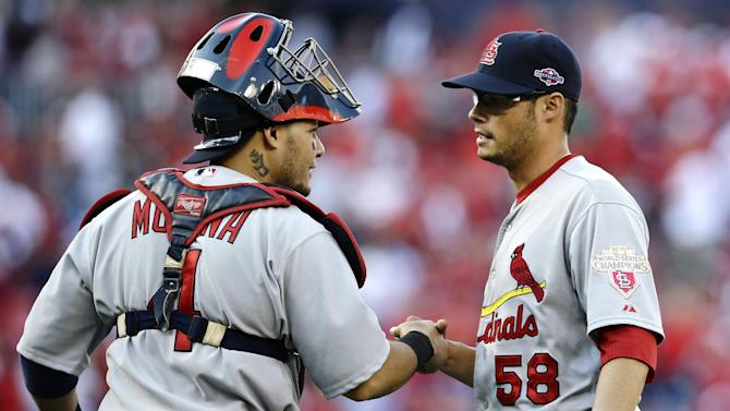 St. Louis Cardinals catcher Yadier Molina, left, and relief pitcher Joe Kelly shake hands after closing out Game 3 of the National League division baseball series against the Washington Nationals on Wednesday, Oct. 10, 2012, in Washington. St. Louis won 8-0. (AP Photo/Alex Brandon)