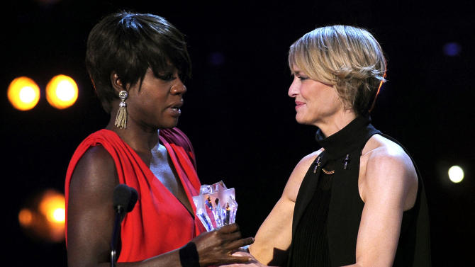 "Robin Wright, right, presents Viola Davis with the award for best actress for ""The Help"" during the 17th Annual Critics' Choice Movie Awards on Thursday, Jan. 12, 2012 in Los Angeles. (AP Photo/Chris Pizzello)"
