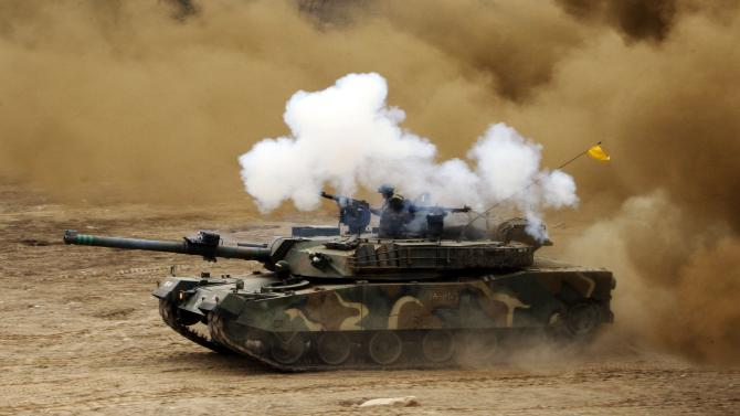 A South Korean army tank moves during an exercise against possible attacks by North Korea near the demilitarized zone (DMZ) in Hwacheon, South Korea, Monday, April 1, 2013. After weeks of war-like rhetoric, North Korean leader Kim Jong Un gathered legislators Monday for an annual spring parliamentary session taking place one day after top party officials adopted a statement declaring building nuclear weapons and the economy the nation's top priorities. (AP Photo/Yonhap, Lee Hae-ryong) KOREA OUT
