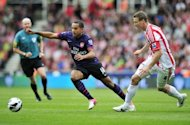 Arsenal striker Theo Walcott (L) vies with Stoke City defender Robert Huth. Arsenal were held to a second consecutive goalless Premier League draw by Stoke City at the Britannia Stadium