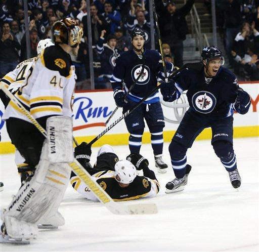 Marchand's goal in 3rd lifts Bruins over Jets 3-2