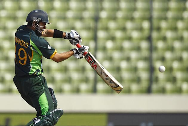 Pakistan's Ahmed Shehzad plays a shot against Sri Lanka during their Asia Cup final cricket match in Dhaka, Bangladesh, Saturday, March 8, 2014