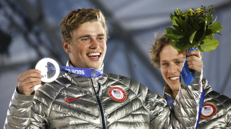 Silver medalist Kenworthy of the U.S. celebrates during the medal ceremony of the men's freestyle skiing slopestyle finals at the 2014 Sochi Winter Olympics