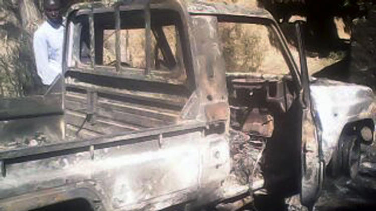 A man looks at a burned armed vehicle used by radical Islamists in Diabaly, some 460 kilometers (286 miles) north of the capital Bamako, Sunday Jan. 20, 2013. The Malian military announced late Saturday that the government was now controlling Diabaly, marking an important accomplishment for the French-led offensive to oust the extremists from northern and central Mali. (AP Photo)
