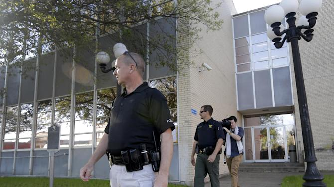 Kaufman law enforcement officers patrol outside the county courthouse Monday, April 1, 2013, in Kaufman, Texas.   Law enforcement officials throughout Texas remained on high alert Monday seeking to better protect prosecutors and their staffs following the killing of county district attorney whose assistant was gunned down just months ago. (AP Photo/Tony Gutierrez)(AP Photo/Tony Gutierrez)(AP Photo/Tony Gutierrez)